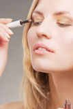 Blonde woman doing eyes lashes Stock Image