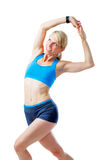 Blonde woman doing fitness exercises. Isolated on white Royalty Free Stock Photos