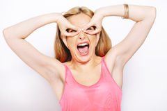 Blonde woman doing funny expressions isolated on white Royalty Free Stock Photography