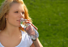 Blonde woman drinking water Royalty Free Stock Photo