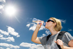 Blonde woman drinking water Royalty Free Stock Images