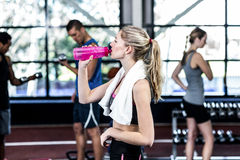 Blonde woman drinking water after working out Royalty Free Stock Photography