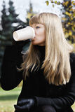 Blonde woman drinks coffee Royalty Free Stock Photos