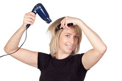 Blonde woman with a dryer Stock Image