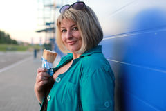 Blonde woman eat ice cream outdoor Royalty Free Stock Photography