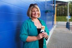 Blonde woman eat ice cream outdoor Stock Photo