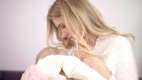 Feminine woman enjoy breastfeeding child. Mother breast feeding kid