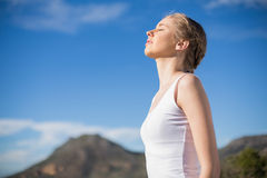 Blonde woman enjoying the sun Royalty Free Stock Images