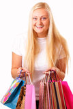 Blonde woman enjoys shopping Stock Photography
