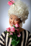 Blonde woman with fake flowers Stock Photos