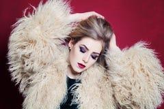 Blonde Woman in Fashion Fur Coat Royalty Free Stock Photo