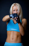 Blonde woman during fight Stock Photos