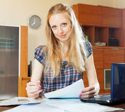 Blonde woman fills in documents Royalty Free Stock Images