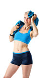 Blonde woman after fitness workout drying herself with a towel Royalty Free Stock Photography