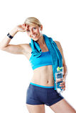 Blonde woman after fitness workout with water bottle and blue towel around her neck Royalty Free Stock Photography