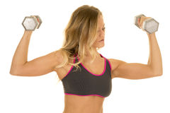 Blonde woman flex weights gray sports bra Royalty Free Stock Photo