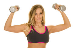 Blonde woman flex weights gray sports bra looking Royalty Free Stock Images