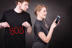 Blonde woman flirting texting on mobile phone. Betrayal and broken heart. Young blonde happy smiling women flirting texting on mobile phone smartphone and sad stock image