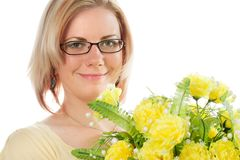 Blonde woman with flowers Royalty Free Stock Photography