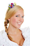 Blonde woman with flowers in her hair Royalty Free Stock Images