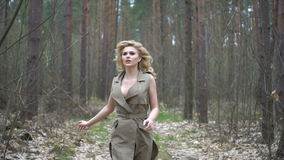 Blonde woman in the forest stock video footage