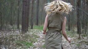 Blonde woman in the forest running stock video footage