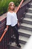 Blonde woman in full figure standing on the stairs outdoors Stock Photography