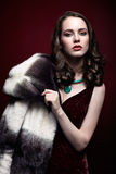 Blonde woman in fur coat Royalty Free Stock Images