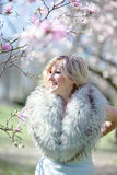 Blonde woman in fur stole Royalty Free Stock Images
