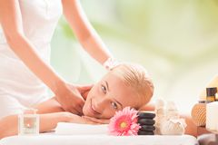 blonde woman getting a massage royalty free stock images