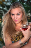 blonde woman  with a glass Royalty Free Stock Photos