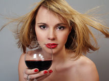 Blonde woman with glass red wine Stock Images