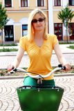 Blonde Woman WIth Glasses on Bicycle Stock Images