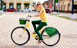 Blonde Woman With Glasses on Bicycle Royalty Free Stock Image