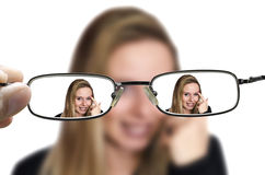 Blonde woman through glasses Royalty Free Stock Photo