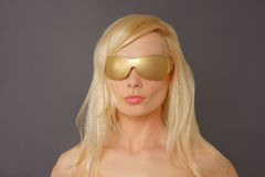 Blonde Woman with Gold Glasses Royalty Free Stock Photo
