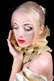 Blonde woman with golden venetian mask Royalty Free Stock Photography