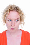 Blonde woman grimacing in front of camera Royalty Free Stock Images