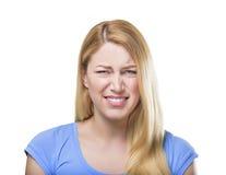 Blonde woman grimacing. Royalty Free Stock Image