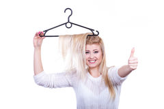 Blonde woman with hair in clothes hanger Royalty Free Stock Photos