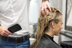 Blonde woman in hair salon Royalty Free Stock Photography