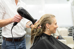 Blonde woman in hair salon Royalty Free Stock Image