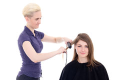 Blonde woman hair stylist doing haircut to beautiful woman isola Stock Photo