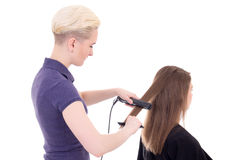 Blonde woman hair stylist doing haircut to client isolated on wh Stock Image