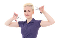 Blonde woman hair stylist posing with scissors isolated on white Stock Photography
