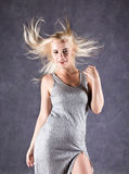Blonde woman with hair in the wind. sexy girl with flying hair. beauty concept Stock Photography