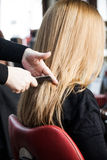 Blonde woman at hairdresser Stock Image