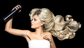 Blonde woman with a hairspray Stock Photography
