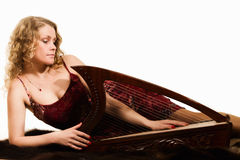 Blonde woman with a harp in his hand Stock Image
