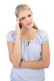 Blonde woman has headache Stock Photo